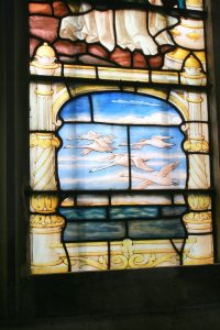 Michael Mack memorial window - swans over the sea